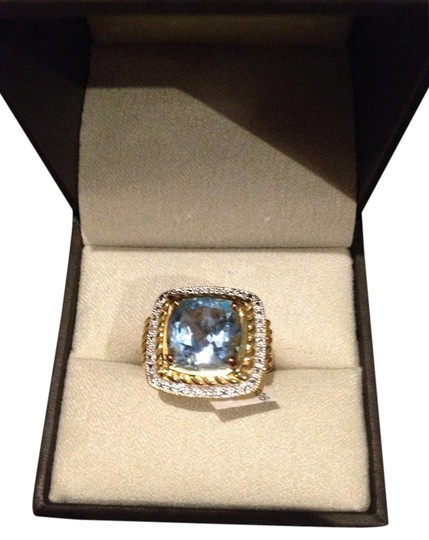 Preload https://item2.tradesy.com/images/ross-simons-blue-topaz-gold-with-small-diamonds-surrounding-the-stone-new-stunning-896-ct-ring-10402966-0-5.jpg?width=440&height=440
