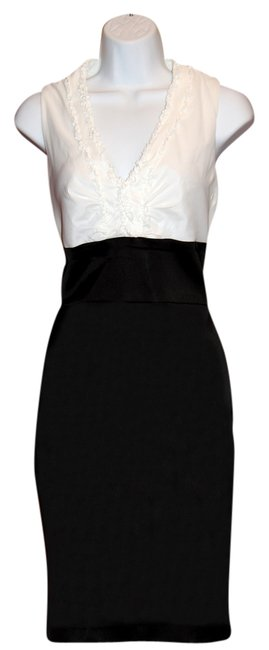 Preload https://img-static.tradesy.com/item/10407259/xscape-white-and-black-elegant-new-high-low-night-out-dress-size-4-s-0-1-650-650.jpg