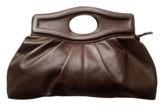 Preload https://item1.tradesy.com/images/wet-seal-chocolate-brown-pleather-clutch-10407715-0-1.jpg?width=440&height=440
