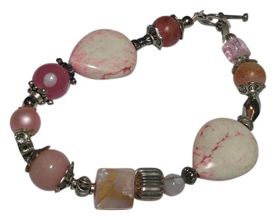 Preload https://item3.tradesy.com/images/pink-silver-howlite-pearl-quartz-and-glass-handmade-a070-bracelet-10415572-0-1.jpg?width=440&height=440