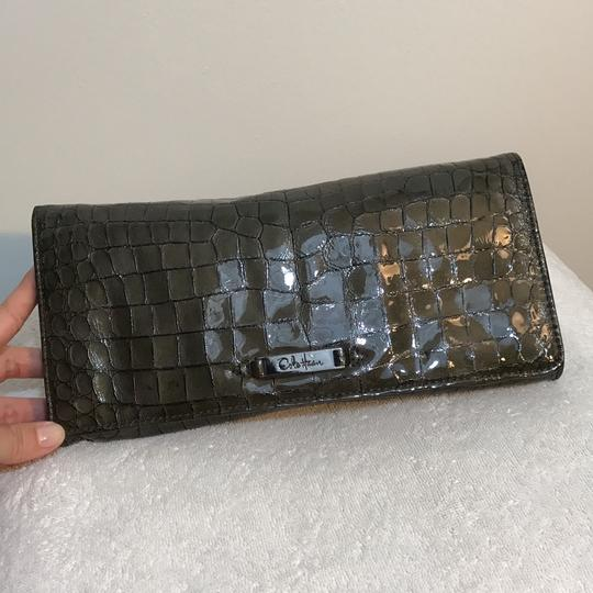 Preload https://img-static.tradesy.com/item/10421854/cole-haan-unknown-metallic-clutch-0-2-540-540.jpg