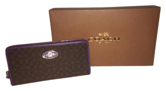 Preload https://item4.tradesy.com/images/coach-brown-with-purple-trim-brownpurple-logo-wallet-10423738-0-1.jpg?width=440&height=440