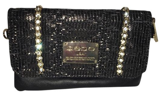 Preload https://item5.tradesy.com/images/bebe-black-leather-clutch-10427674-0-1.jpg?width=440&height=440