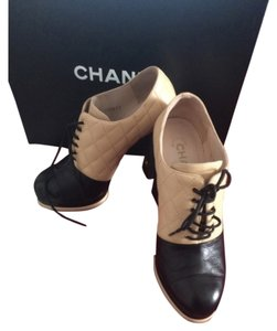 Chanel Beige with Black Boots