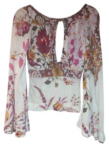 Just Cavalli Top White with Pink And Green Flowers And discreet golden stitches.