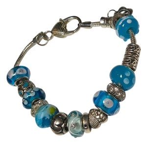 Charm Bracelet with 17 blue and silver charms B073