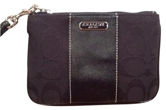 Preload https://item3.tradesy.com/images/coach-black-leather-and-fabric-wristlet-10444972-0-1.jpg?width=440&height=440