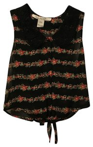 American Rag Top Black with an orange floral pattern