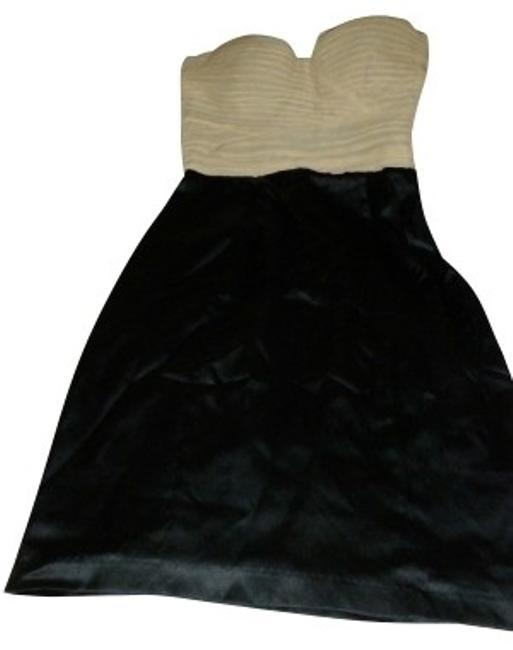 Preload https://item1.tradesy.com/images/guess-blackcream-night-out-dress-size-10-m-1045-0-0.jpg?width=400&height=650