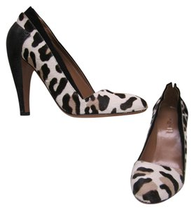 ALAÏA Leather Ponyhair Leopard Pumps