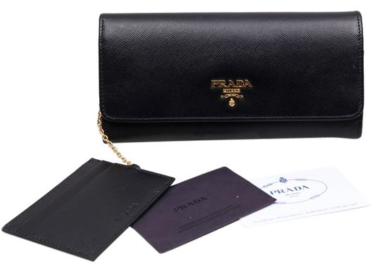 Preload https://img-static.tradesy.com/item/10483741/prada-wallet-black-saffiano-cuir-leather-clutch-0-1-540-540.jpg