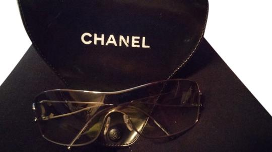 Preload https://item3.tradesy.com/images/chanel-gunmetal-frames-with-gray-graduated-lenses-and-rhinestones-on-cc-sunglasses-10488532-0-1.jpg?width=440&height=440