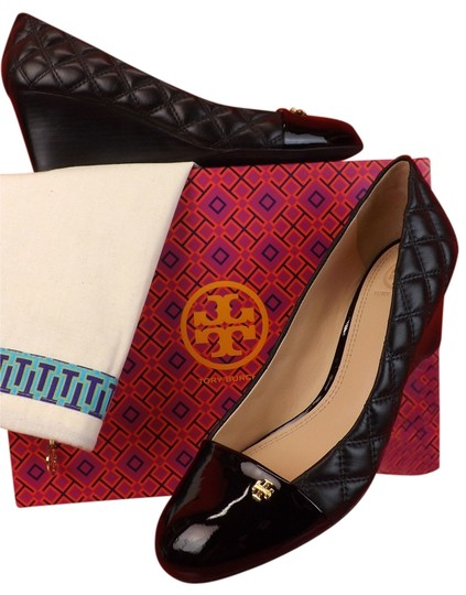 Preload https://item4.tradesy.com/images/tory-burch-black-claremont-quilted-leather-cap-toe-gold-reva-wedges-size-us-95-regular-m-b-10493188-0-1.jpg?width=440&height=440