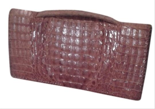 Preload https://img-static.tradesy.com/item/10511128/vintage-crocodile-rusty-brown-alligator-skin-leather-clutch-0-1-540-540.jpg