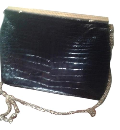 Preload https://item4.tradesy.com/images/saks-fifth-avenue-made-in-france-vintage-clutch-black-with-golden-hardware-leather-baguette-10511248-0-1.jpg?width=440&height=440