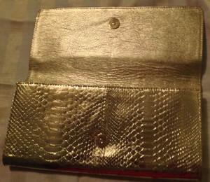 Michael Kors Made In Italy Gold Clutch