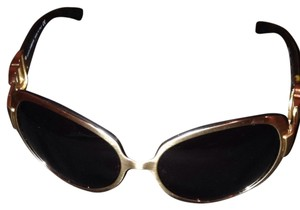 Preload https://item2.tradesy.com/images/dolce-and-gabbana-gold-brown-d-and-g-style2031-sunglasses-1052486-0-0.jpg?width=440&height=440