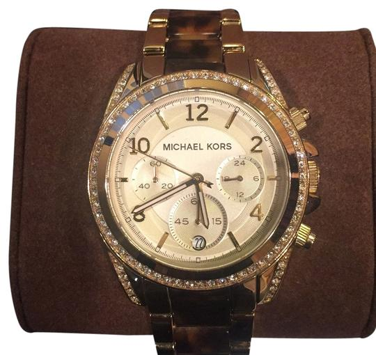 Preload https://item3.tradesy.com/images/michael-kors-gold-tone-and-tortoise-watch-10534807-0-1.jpg?width=440&height=440