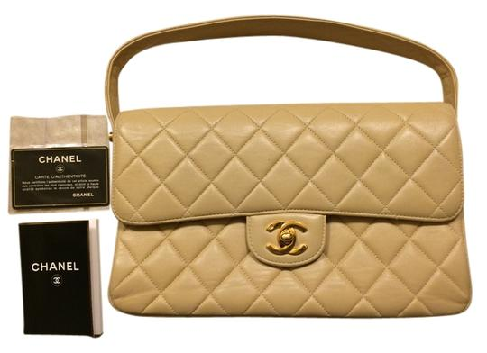 Preload https://item3.tradesy.com/images/chanel-10-inch-double-sided-flap-handbag-beige-quilted-leather-shoulder-bag-10539877-0-2.jpg?width=440&height=440