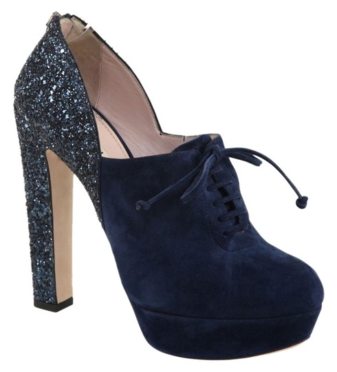 Preload https://item1.tradesy.com/images/miu-miu-dark-blue-navy-suede-leather-lace-up-ankle-bootie-platforms-size-us-105-regular-m-b-10544605-0-1.jpg?width=440&height=440