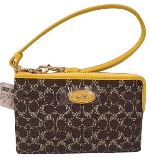 Preload https://item2.tradesy.com/images/coach-signature-corner-zip-saddleyellow-coated-canvas-wristlet-10547161-0-1.jpg?width=440&height=440