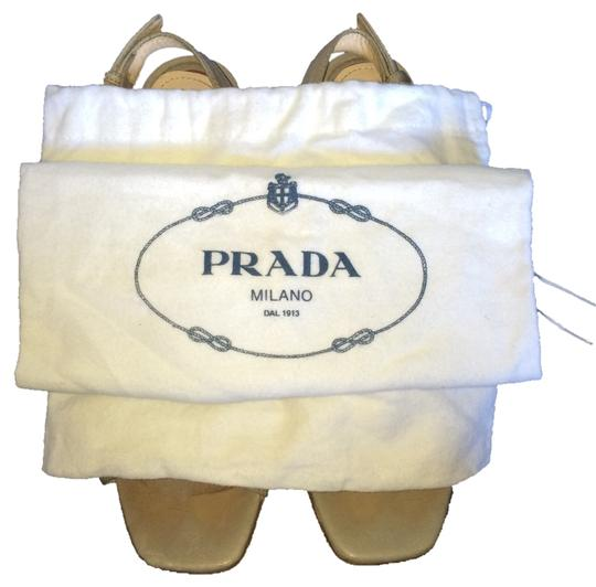 Preload https://item2.tradesy.com/images/prada-olive-grey-strappy-wedge-sandals-size-us-7-regular-m-b-10551766-0-1.jpg?width=440&height=440