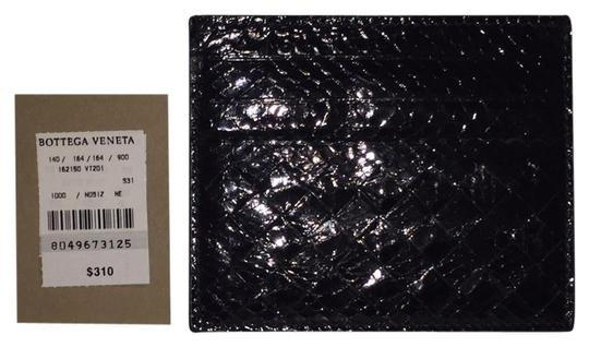Preload https://img-static.tradesy.com/item/10557631/bottega-veneta-patent-black-card-case-wallet-0-1-540-540.jpg