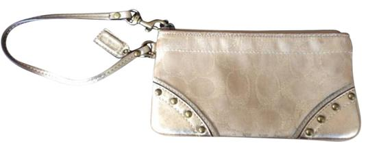 Preload https://item4.tradesy.com/images/coach-gold-leather-wristlet-10576978-0-2.jpg?width=440&height=440