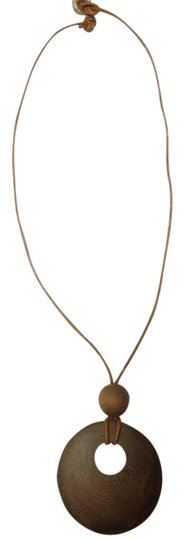 Preload https://item5.tradesy.com/images/banana-republic-dark-brown-and-tan-wood-necklace-1058074-0-0.jpg?width=440&height=440