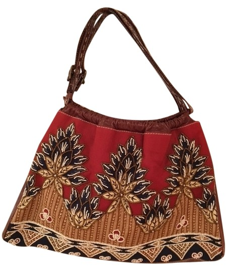 Preload https://item3.tradesy.com/images/isabella-fiore-body-leather-handles-and-beaded-design-rustnavytans-with-beading-material-fabric-hobo-10581622-0-1.jpg?width=440&height=440