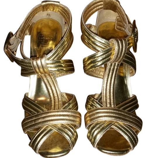 Preload https://item5.tradesy.com/images/tory-burch-gold-metallic-sexy-strappy-heels-sz9-pumps-size-us-9-10585384-0-1.jpg?width=440&height=440