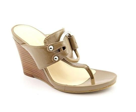 Preload https://img-static.tradesy.com/item/1058870/calvin-klein-patent-leather-open-toe-wedge-sandals-size-us-85-regular-m-b-0-0-540-540.jpg