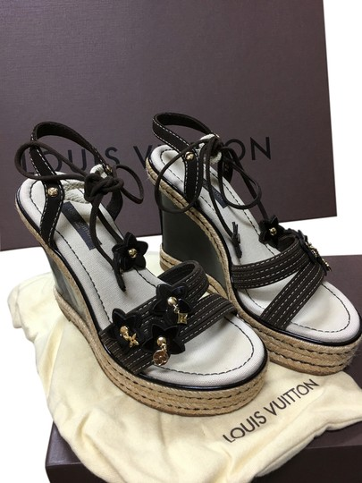 Preload https://item4.tradesy.com/images/louis-vuitton-brown-flower-patent-leather-suede-wedges-size-us-45-regular-m-b-10590253-0-1.jpg?width=440&height=440