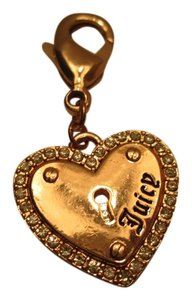 Juicy Couture Juicy Couture Gold color Heart Charm with sparkle
