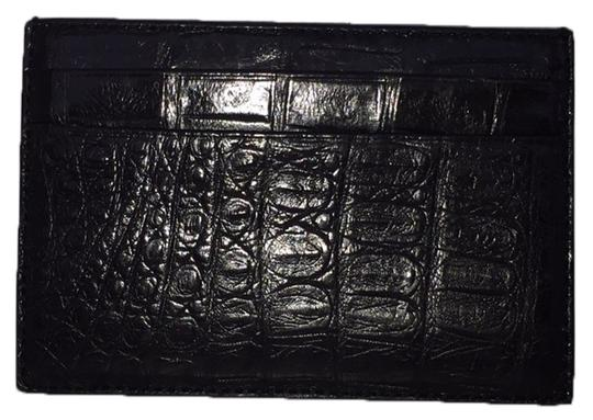 Preload https://item5.tradesy.com/images/coach-blac-aligator-card-case-wallet-10603279-0-1.jpg?width=440&height=440