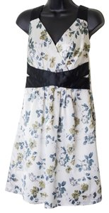Romy short dress Multi-Color Size Small Floral Sleeveless on Tradesy