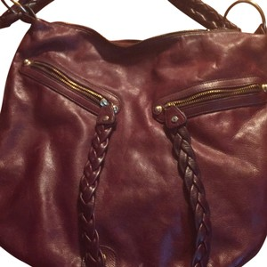 Bag was designed in NYC by a woman who makes accessories Hobo Bag