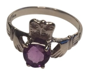 Like new 14kt White gold claddagh ring with purple amethyst