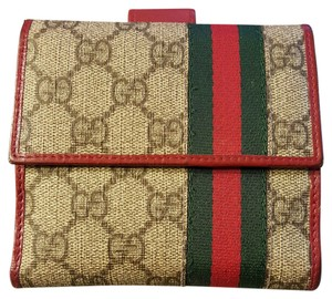 Gucci Beige with red leather trim and green/red web Clutch