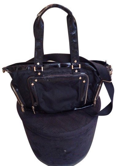 Preload https://item5.tradesy.com/images/tory-burch-patent-leather-black-tote-1066494-0-0.jpg?width=440&height=440