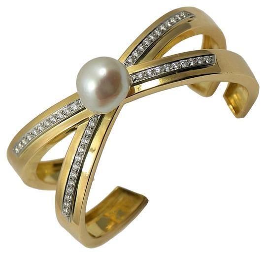 Preload https://item2.tradesy.com/images/tiffany-and-co-yellow-gold-vintage-paloma-picasso-diamond-x-bangle-with-pearl-bracelet-1069461-0-0.jpg?width=440&height=440