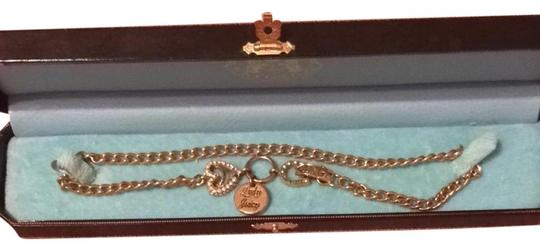 Preload https://item2.tradesy.com/images/juicy-couture-gold-lady-necklace-1069616-0-0.jpg?width=440&height=440
