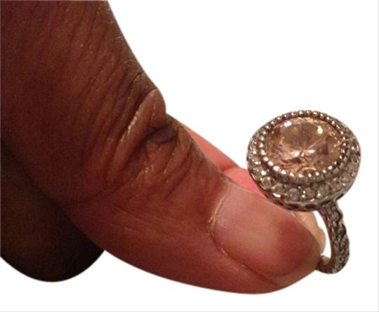 Preload https://item4.tradesy.com/images/pink-stone-surrounded-by-crystal-stones-costume-ring-1069928-0-0.jpg?width=440&height=440