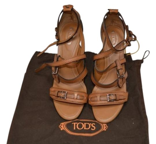 Preload https://item3.tradesy.com/images/tod-s-beigebrown-luggage-leather-buckle-detail-sandals-size-us-10-regular-m-b-1069937-0-0.jpg?width=440&height=440