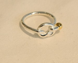 Tiffany & Co. silver 18 K gold love knot ring