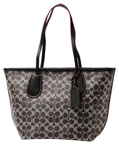 Coach 34595 Signature Pvc Pvc And Leather Handbag And Tote in Saddle / Black