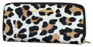a83688125066 Michael Kors Leopard Print Jet Set Travel Hair Calf Wallet - Tradesy
