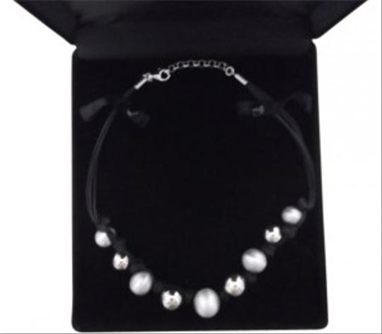 Preload https://item1.tradesy.com/images/sterling-silver-with-black-cord-necklace-107555-0-0.jpg?width=440&height=440