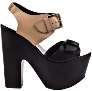 Report Signature Black with tan strap Wedges