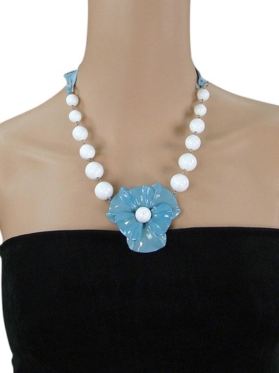 Preload https://item4.tradesy.com/images/moschino-blue-white-pale-enameled-flower-necklace-1080153-0-0.jpg?width=440&height=440
